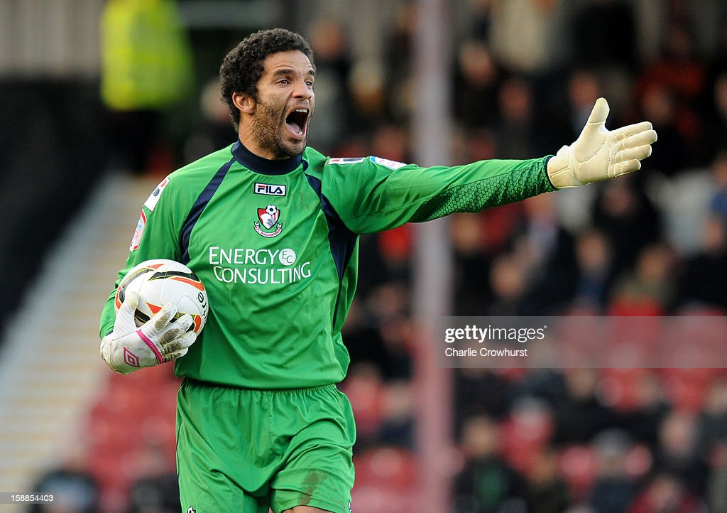 David James of Bournemouth shouts at his defence during the npower League One match between Brentford and Bournemouth at Griffin Park on January 01, 2013 in London England.