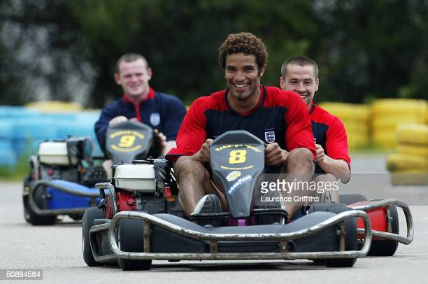 David James of England leads Michael Owen and Wayne Rooney in a GoKart race during the England Training and Press Conference held at the England...