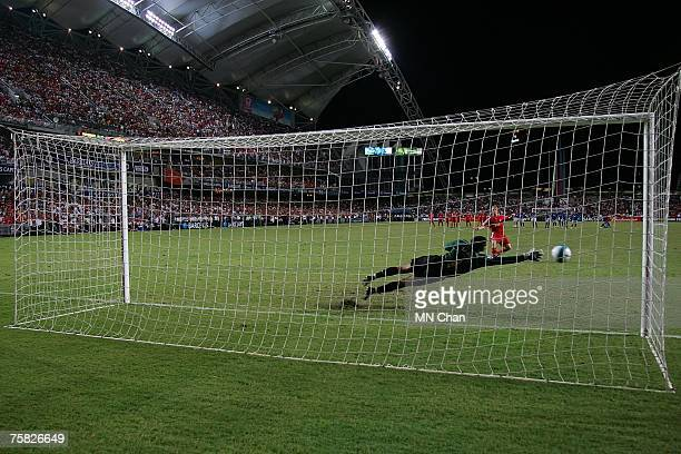 David James of Portsmouth in action during the penalty kick by Dirk Kuyt of Liverpool of the preseason Barclays Asia Trophy final match between...