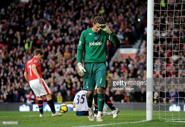 David James of Portsmouth looks dejected after conceding the 5th goal during the Barclays Premier League match between Manchester United and...