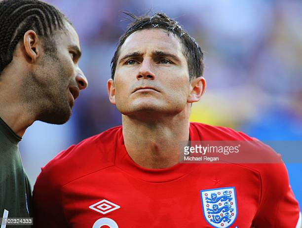 David James speaks to Frank Lampard of England as they line up for the national anthems during the 2010 FIFA World Cup South Africa Group C match...