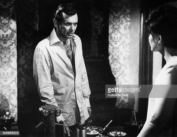 David Janssen talks to Brenda Vaccaro in a scene for the United Artist movie 'Where It's At' circa 1968