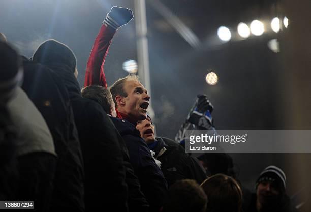 David Jarolim of Hamburg celebrates with the fans after winning the Bundesliga match between 1 FC Koeln and Hamburger SV at RheinEnergieStadion on...