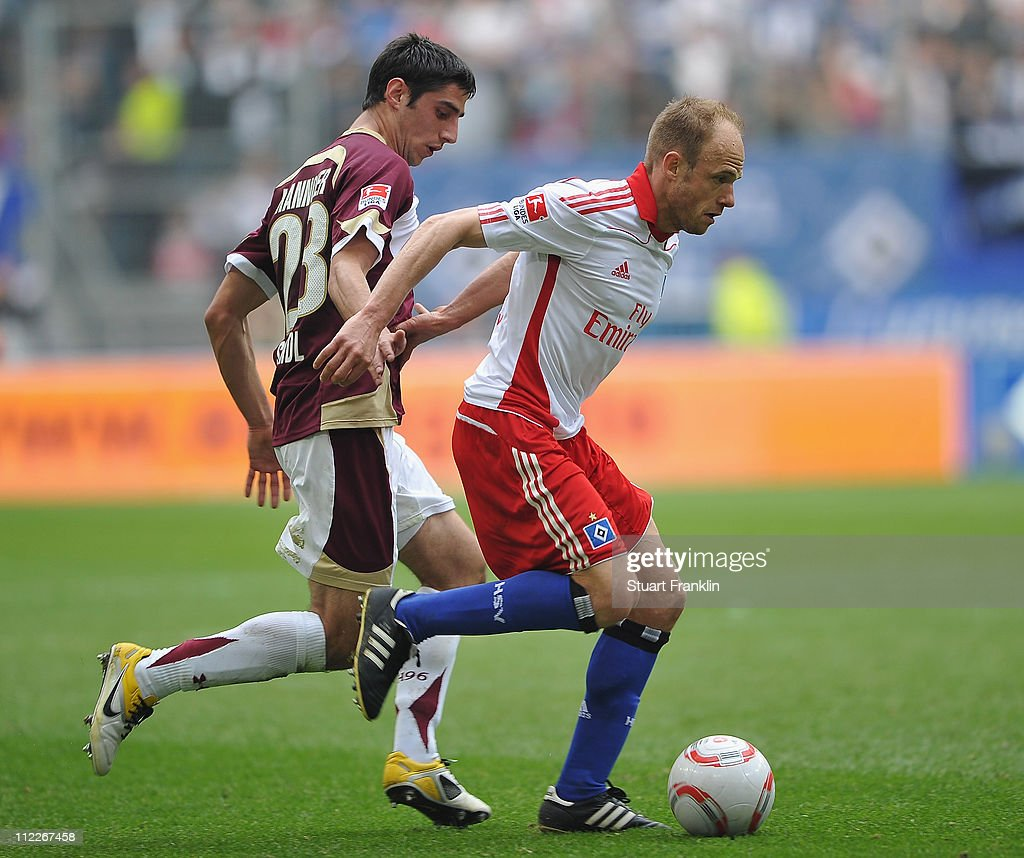 David Jarolim of Hamburg is challenged by Sofian Chahed of Hannover during the Bundesliga match between Hamburger SV and Hannover 96 at Imtech Arena...
