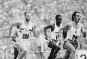 David Jenkins of Great Britain races against Jan Balachowski of Poland and Julius Sang of Kenya during the Men's 4 × 400 metres Relay at the XX...