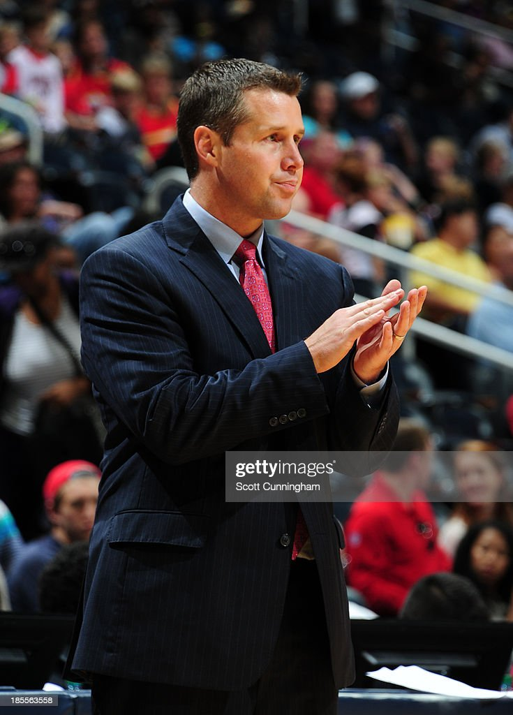 <a gi-track='captionPersonalityLinkClicked' href=/galleries/search?phrase=David+Joerger&family=editorial&specificpeople=4024956 ng-click='$event.stopPropagation()'>David Joerger</a> of the Memphis Grizzlies cheers his team on from the bench during the game against the Atlanta Hawks on October 20, 2013 at Philips Arena in Atlanta, Georgia.