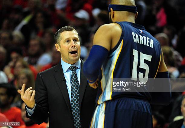 David Joerger of the Memphis Grizzlies speaks with Vince Carter of the Memphis Grizzlies during the third quarter in Game Three of the Western...