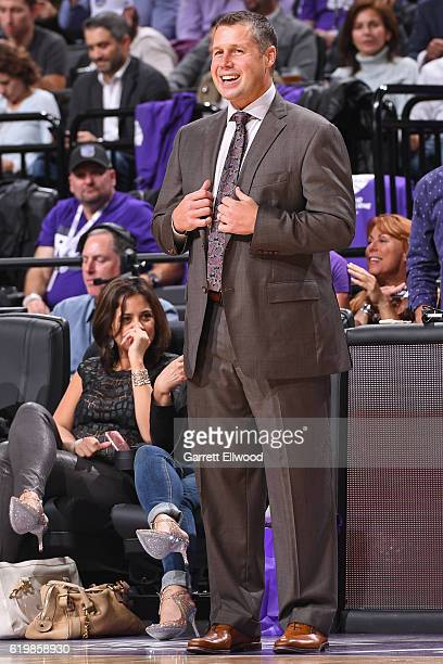 David Joerger of the Sacramento Kings smiles and coaches during the game against the San Antonio Spurs on October 27 2016 at the Golden 1 Center in...