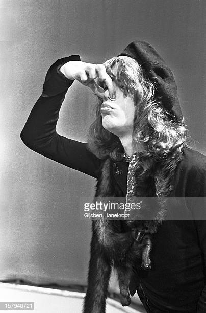 David Johansen from The New York Dolls holds his nose between his fingers on TopPop TV show for AVRO TV at Hilversum Studios on December 06 1973