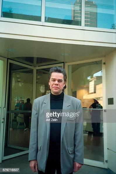 David Johansen wearing a gray jacket posing on the street circa 1990 New York
