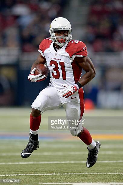 David Johnson of the Arizona Cardinals carries the ball in the first quarter against the St Louis Rams at the Edward Jones Dome on December 6 2015 in...