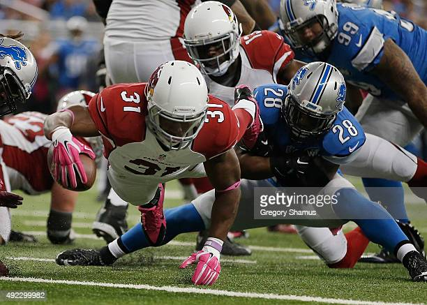 David Johnson of the Arizona Cardinals dives for a second quarter touchdown past Quandre Diggs of the Detroit Lions at Ford Field on October 11 2015...