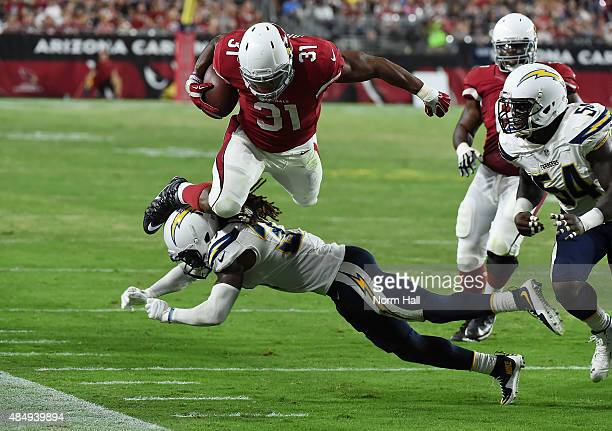 David Johnson of the Arizona Cardinals dives over the top of Jahleel Addae of the San Diego Chargers at University of Phoenix Stadium on August 22...