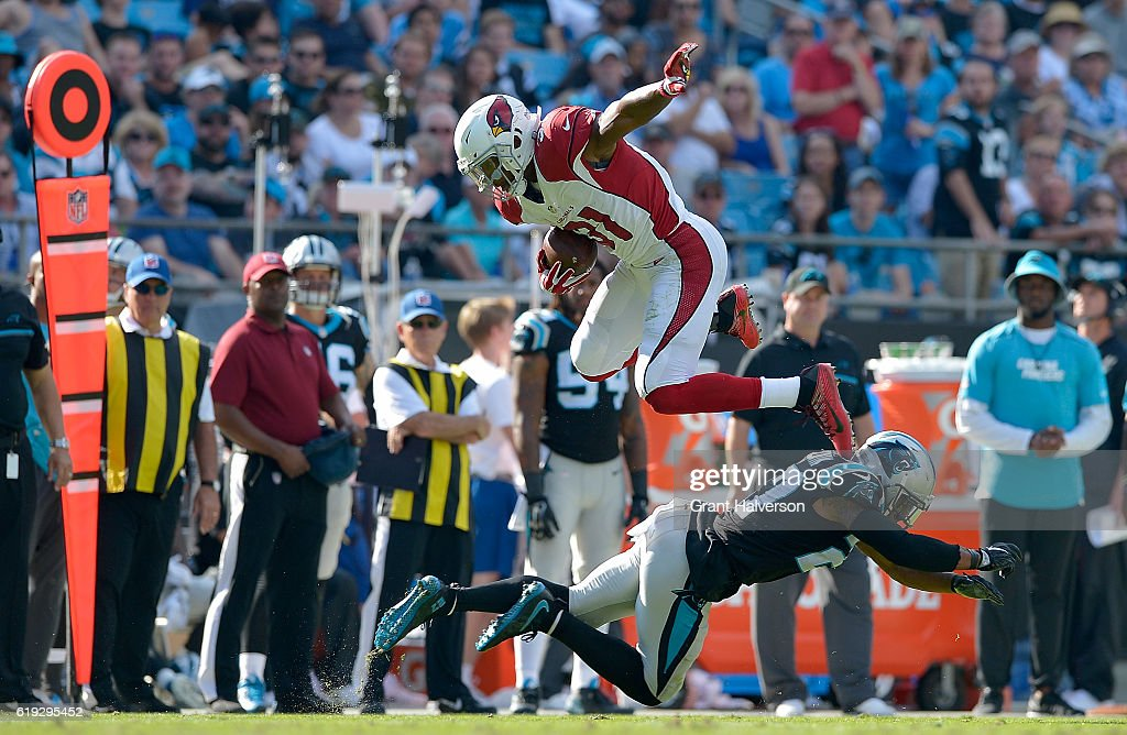 David Johnson #31 of the Arizona Cardinals leaps over Robert McClain #27 of the Carolina Panthers in the 3rd quarter during the game at Bank of America Stadium on October 30, 2016 in Charlotte, North Carolina.