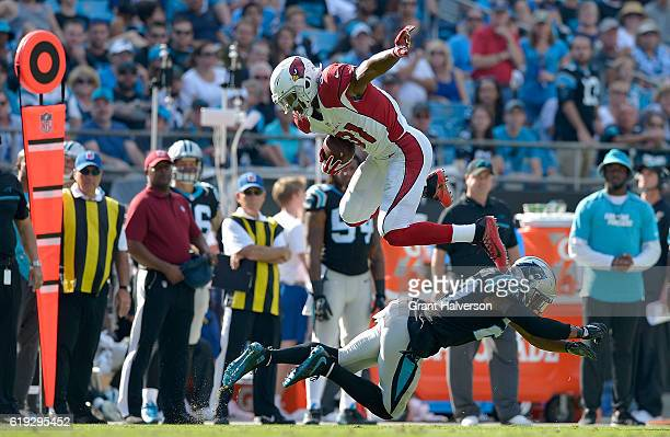 David Johnson of the Arizona Cardinals leaps over Robert McClain of the Carolina Panthers in the 3rd quarter during the game at Bank of America...