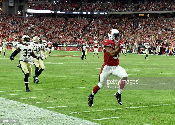 David Johnson of the Arizona Cardinals runs down the sidelines for a 55yard down reception late in the game against the New Orleans Saints at...
