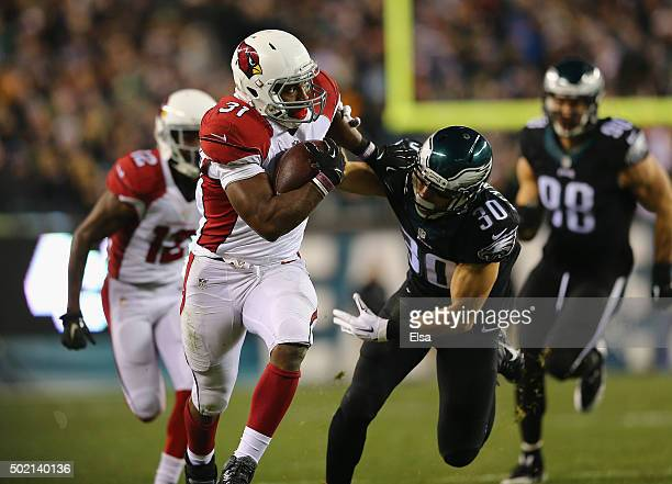 David Johnson of the Arizona Cardinals runs the ball in for a touchdown in the second quarter against Ed Reynolds the Philadelphia Eagles at Lincoln...