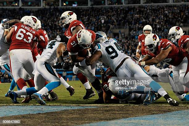 David Johnson of the Arizona Cardinals rushes for a touchdown in the second quarter against the Carolina Panthers during the NFC Championship Game at...