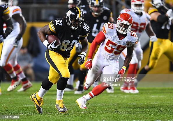David Johnson of the Pittsburgh Steelers carries the ball in front of Justin MarchLillard of the Kansas City Chiefs at Heinz Field on October 2 2016...