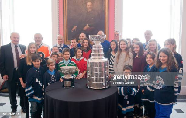David Johnston Governor General of Canada poses with Hockey Hall of Famers and Youth hockey players from the Ottawa and Gatineau region during the...