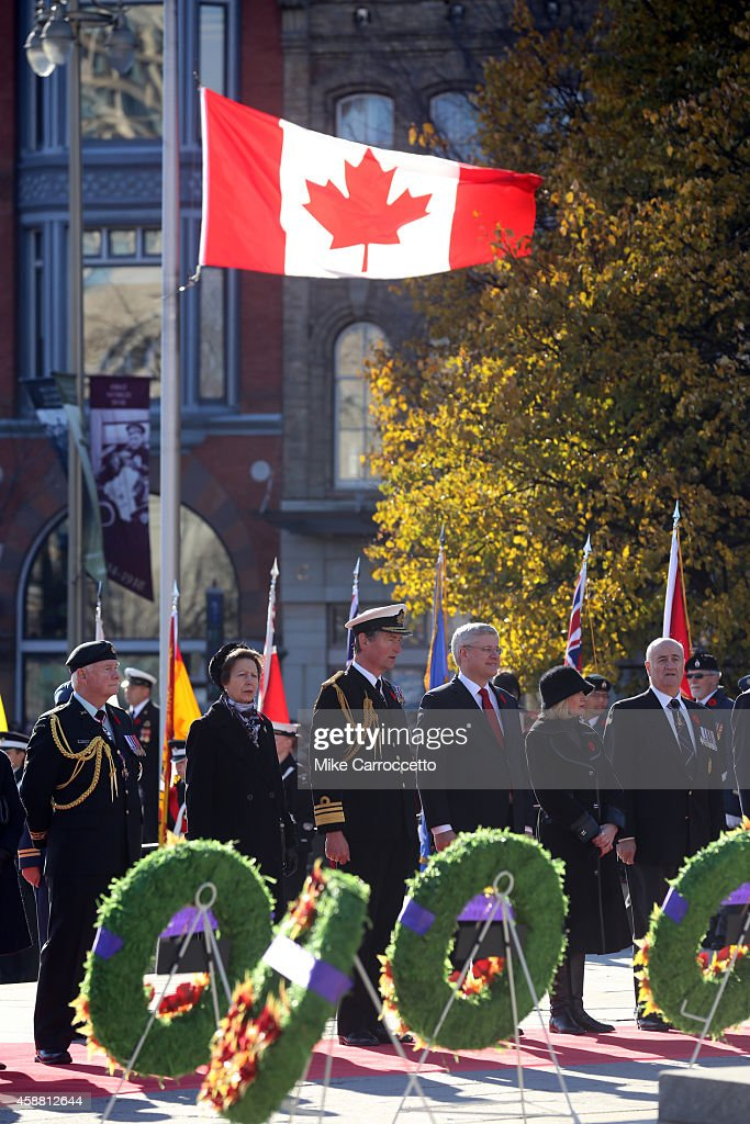 <a gi-track='captionPersonalityLinkClicked' href=/galleries/search?phrase=David+Johnston+-+Politician&family=editorial&specificpeople=7915223 ng-click='$event.stopPropagation()'>David Johnston</a> (Governor General of Canada) <a gi-track='captionPersonalityLinkClicked' href=/galleries/search?phrase=Princess+Anne+-+Princess+Royal&family=editorial&specificpeople=11706204 ng-click='$event.stopPropagation()'>Princess Anne</a>, her husband Sir Tim Laurence, Prime Minister <a gi-track='captionPersonalityLinkClicked' href=/galleries/search?phrase=Stephen+Harper+-+Politician&family=editorial&specificpeople=690870 ng-click='$event.stopPropagation()'>Stephen Harper</a>, his wife Laureen, and Julian Fantino (Minister of Veteran's Affairs) watch this morning's Remembrance Day ceremony, November 11, 2014 in Ottawa, Canada. An estimated 50,000 or more people lined the streets around the War Memorial Monument to take in the ceremony.