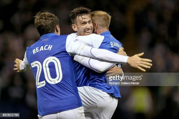 David Jones Adam Reach and Barry Bannan of Sheffield Wednesday celebrate during the Sky Bet Championship match between Sheffield Wednesday and...