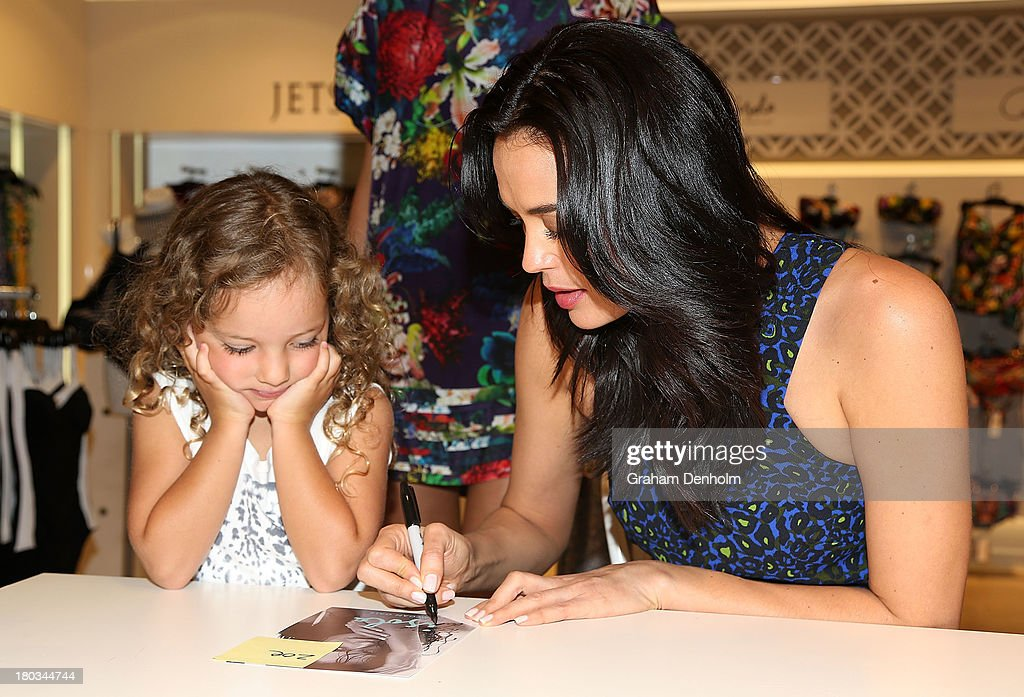 David Jones Brand Ambassador <a gi-track='captionPersonalityLinkClicked' href=/galleries/search?phrase=Megan+Gale&family=editorial&specificpeople=202042 ng-click='$event.stopPropagation()'>Megan Gale</a> meets with young fans at the David Jones Malvern Central launch on September 12, 2013 in Melbourne, Australia.