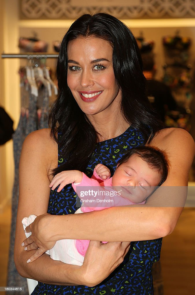 David Jones Brand Ambassador <a gi-track='captionPersonalityLinkClicked' href=/galleries/search?phrase=Megan+Gale&family=editorial&specificpeople=202042 ng-click='$event.stopPropagation()'>Megan Gale</a> poses with a baby at the David Jones Malvern Central launch on September 12, 2013 in Melbourne, Australia.