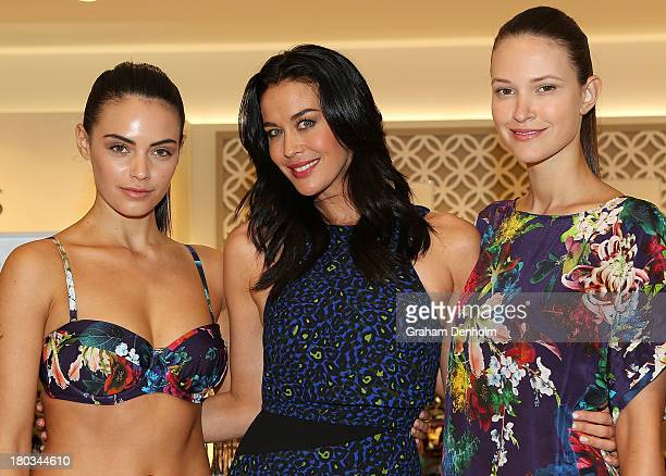 David Jones Brand Ambassador Megan Gale poses with models showcasing designs from her Isola swimwear line at the David Jones Malvern Central launch...
