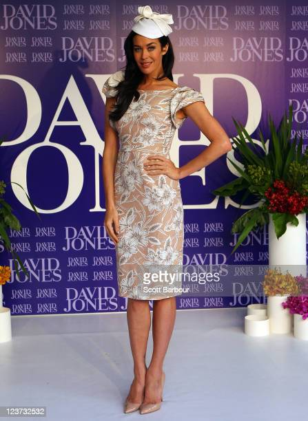 David Jones Brand Ambassador Megan Gale showcases designs by Collette Dinnigan on the catwalk during the David Jones Spring Racewear launch at David...