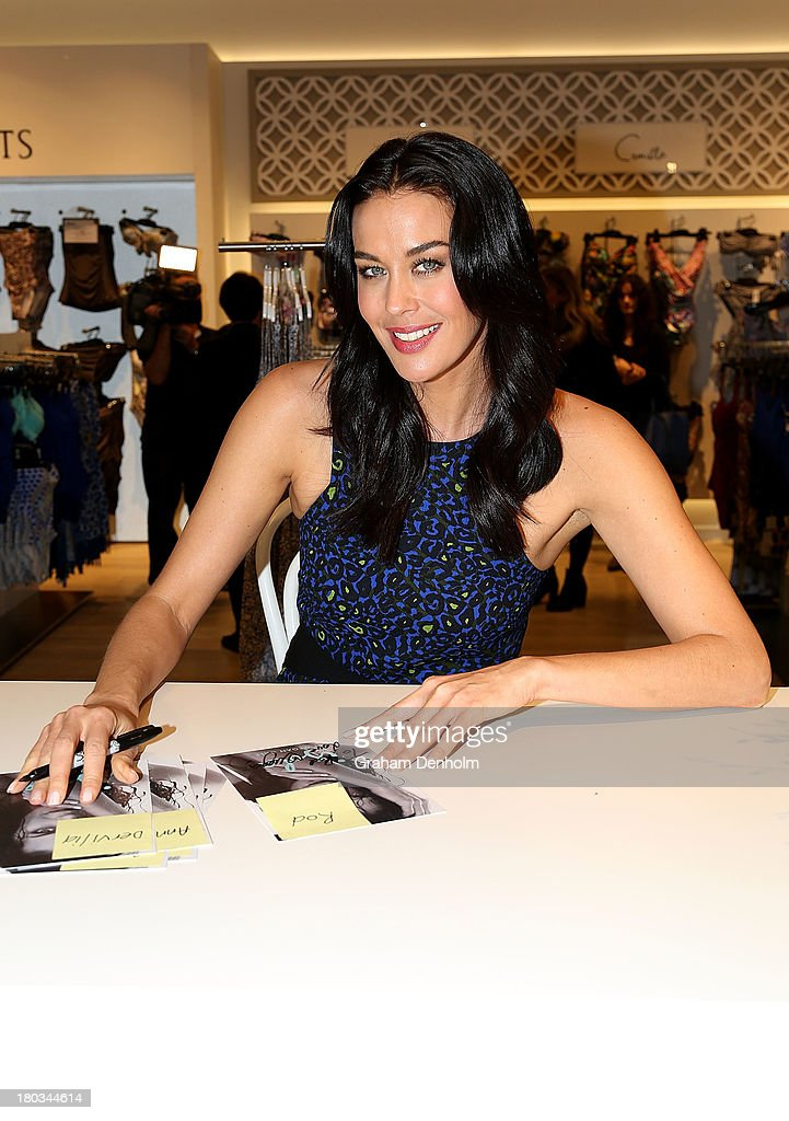 David Jones Brand Ambassador <a gi-track='captionPersonalityLinkClicked' href=/galleries/search?phrase=Megan+Gale&family=editorial&specificpeople=202042 ng-click='$event.stopPropagation()'>Megan Gale</a> signs autographs for fans at the David Jones Malvern Central launch on September 12, 2013 in Melbourne, Australia.
