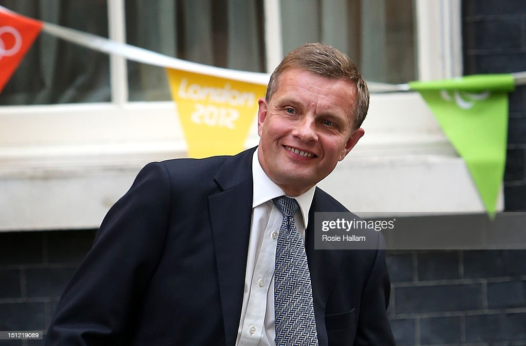 David Jones leaves No 10 Downing Street as Welsh Secretary on the day Prime Minister David Cameron holds a government reshuffle on September 4 2012...