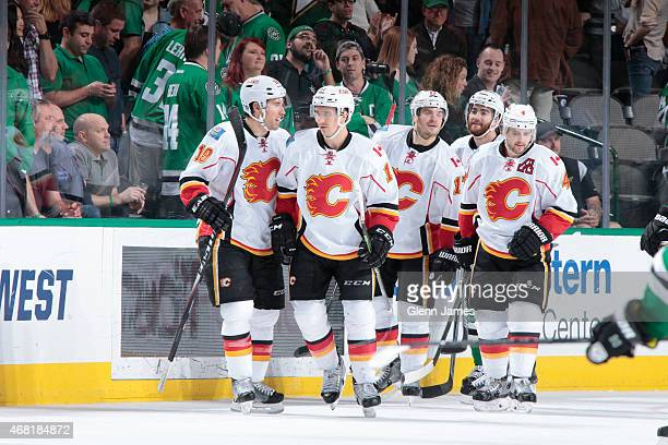 David Jones Mikael Backlund Lance Bouma Kris Russell and the Calgary Flames celebrate a goal against the Dallas Stars at the American Airlines Center...