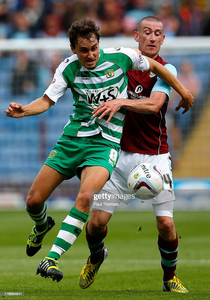 David Jones (R) of Burnley in action with Edward Upson of Yeovil during the Sky Bet Championship match between Burnley and Yeovil Town at Turf Moor on August 17, 2013 in Burnley, England