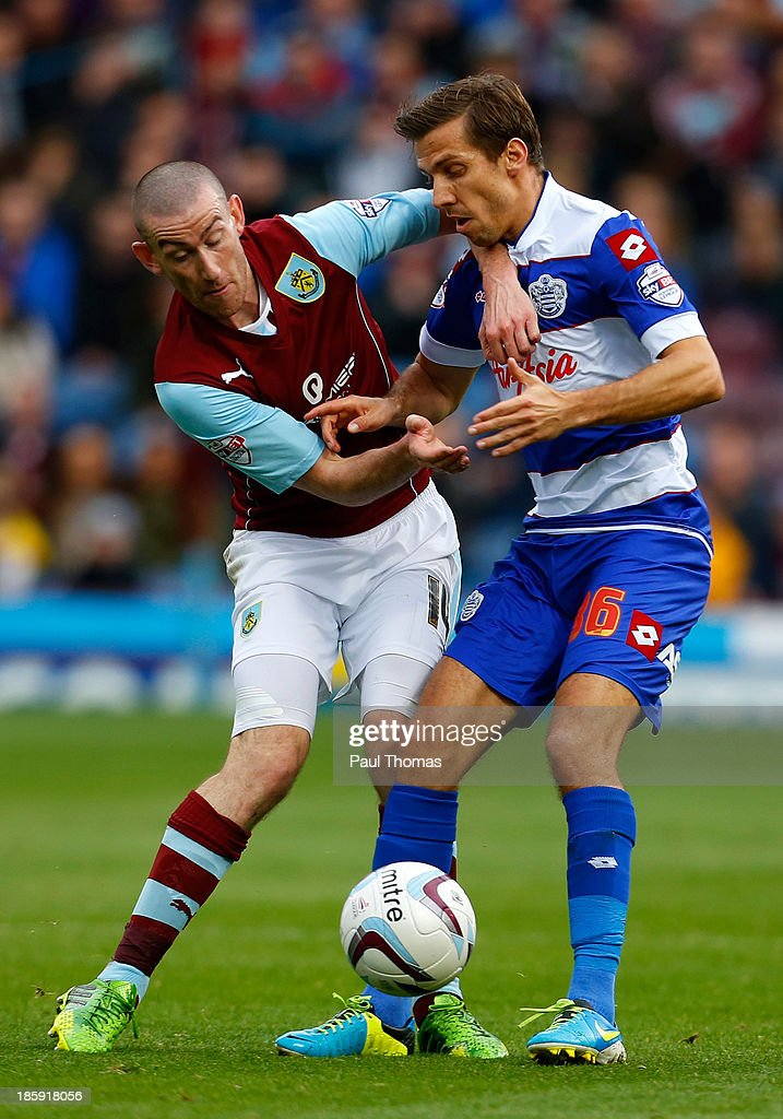 David Jones (L) of Burnley in action with Gary O'Neill of QPR during the Sky Bet Championship match between Burnley and Queens Park Rangers at Turf Moor on October 26, 2013 in Burnley, England.