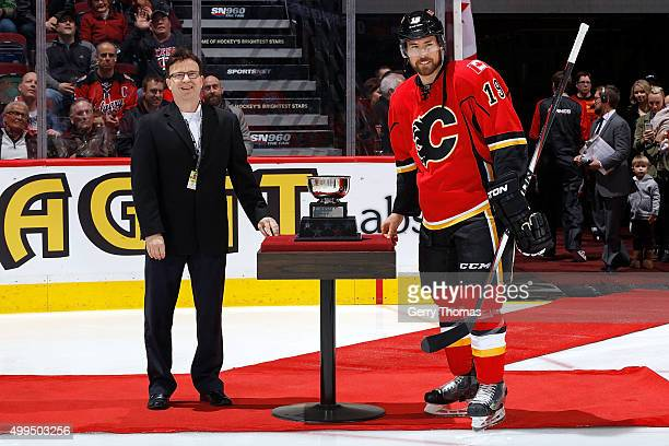 David Jones of the Calgary Flames is awarded the Sportsnet 3 Stars award before an NHL game against the Dallas Stars at Scotiabank Saddledome on...