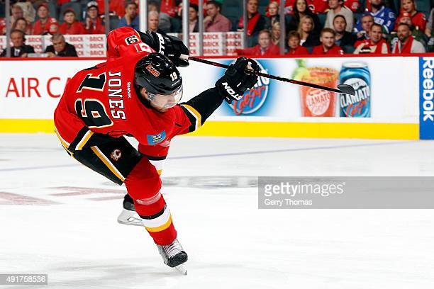 David Jones of the Calgary Flames shoots the puck against the Vancouver Canucks at Scotiabank Saddledome during the NHL season opener on October 7...