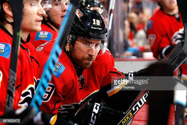 David Jones of the Calgary Flames sits on the bench in between shifts against the New Jersey Devils during an NHL game at Scotiabank Saddledome on...