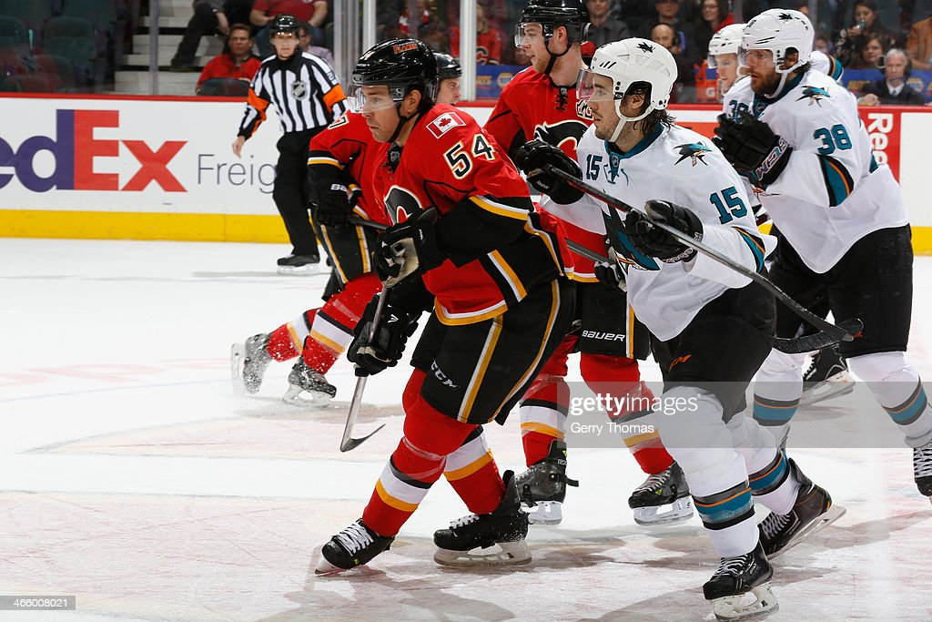 David Jones #38 of the Calgary Flames skates against <a gi-track='captionPersonalityLinkClicked' href=/galleries/search?phrase=James+Sheppard&family=editorial&specificpeople=537966 ng-click='$event.stopPropagation()'>James Sheppard</a> #15 and Bracken Kearns #38 of the San Jose Sharks at Scotiabank Saddledome on January 30, 2014 in Calgary, Alberta, Canada.