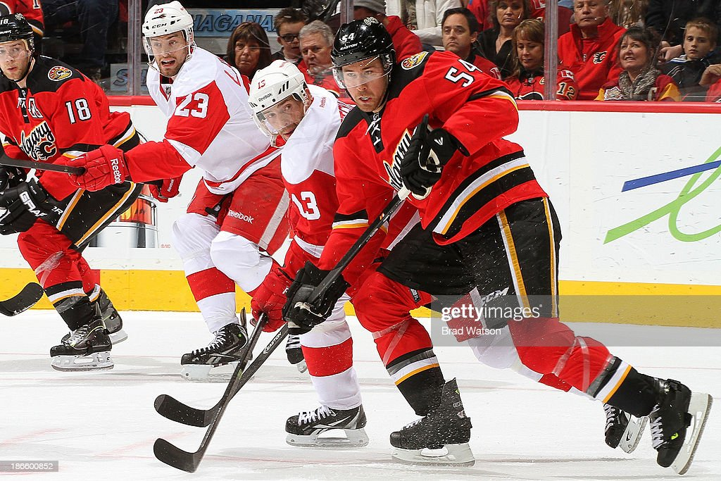 David Jones #54 of the Calgary Flames skates against <a gi-track='captionPersonalityLinkClicked' href=/galleries/search?phrase=Pavel+Datsyuk&family=editorial&specificpeople=202893 ng-click='$event.stopPropagation()'>Pavel Datsyuk</a> #13 of the Detroit Red Wings at Scotiabank Saddledome on November 1, 2013 in Calgary, Alberta, Canada.