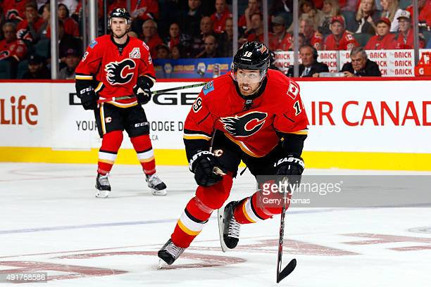 David Jones of the Calgary Flames skates against the Vancouver Canucks at Scotiabank Saddledome during the NHL season opener on October 7 2015 in...