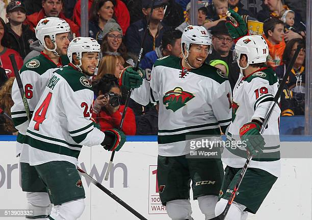 David Jones of the Minnesota Wild celebrates his first period goal against the Buffalo Sabres with teammates Jarret Stoll Matt Dumba and Marco...