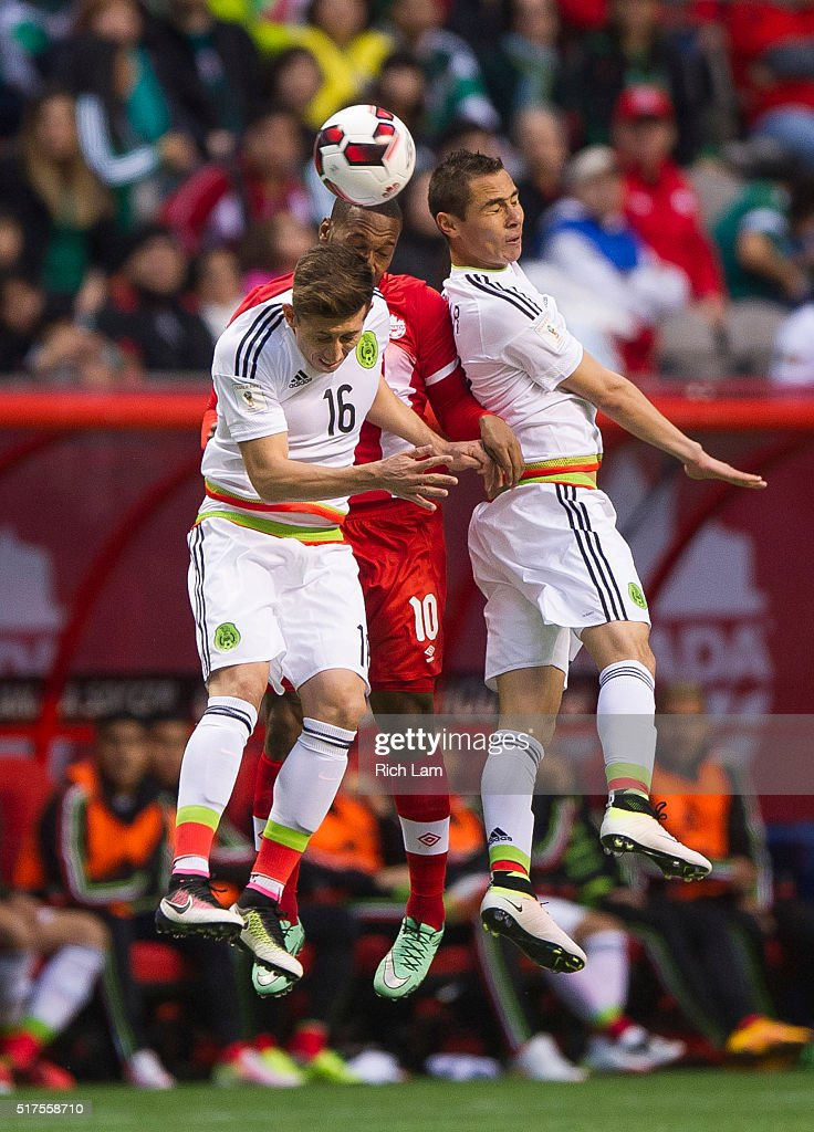 David Junior Hoilett of Canada battles with Hector Herrera and Paul Aguilar of Mexico for the loose ball during FIFA 2018 World Cup Qualifier soccer...