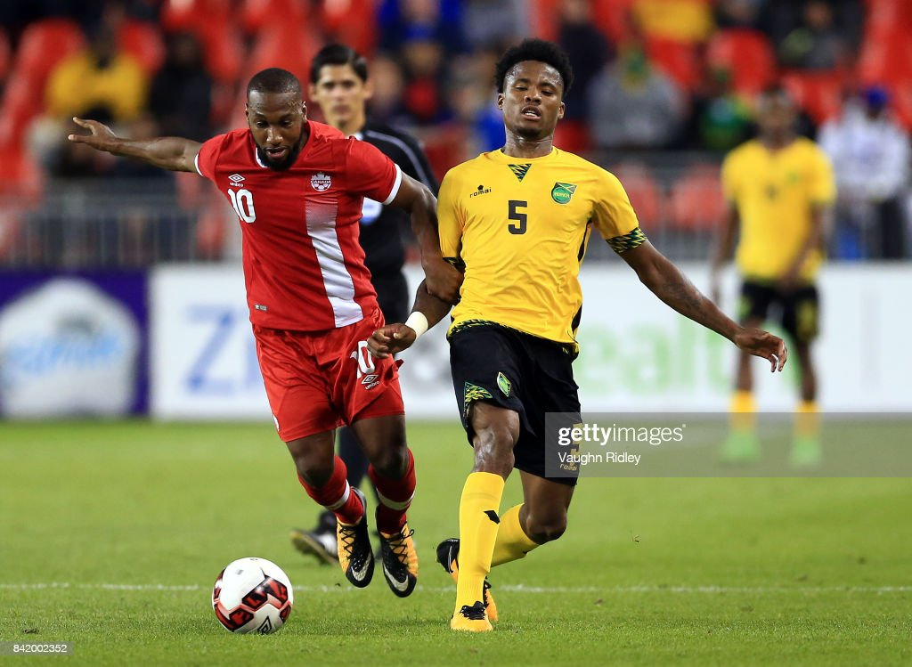 David Junior Hoilett #10 of Canada is tackled by Alvas Powell #5 of Jamaica during the second half of an International Friendly match at BMO Field on September 2, 2017 in Toronto, Canada.