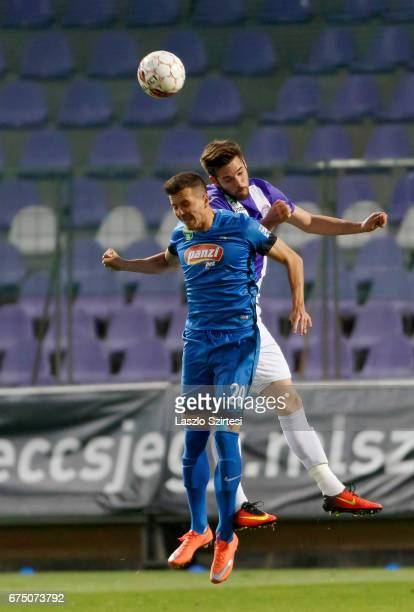 David Kalnoki Kis of Ujpest FC competes for the ball in the air with Adam Hrepka of MTK Budapest during the Hungarian OTP Bank Liga match between...
