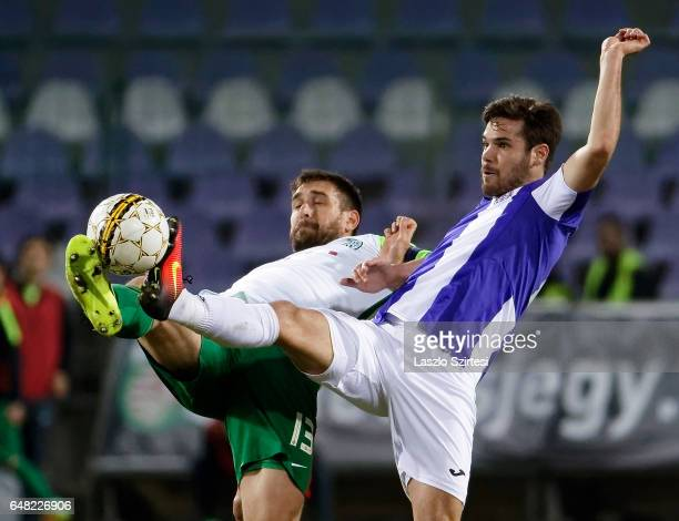 David Kalnoki Kis of Ujpest FC competes for the ball with Daniel Bode of Ferencvarosi TC during the Hungarian OTP Bank Liga match between Ujpest FC...