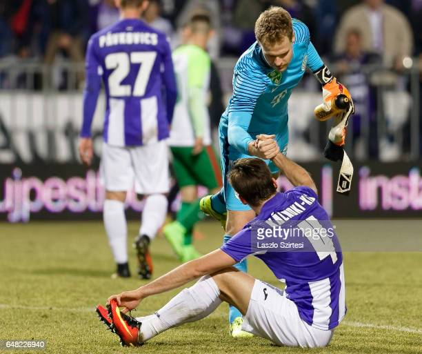 David Kalnoki Kis of Ujpest FC shake hands with goalkeeper Denes Dibusz of Ferencvarosi TC during the Hungarian OTP Bank Liga match between Ujpest FC...