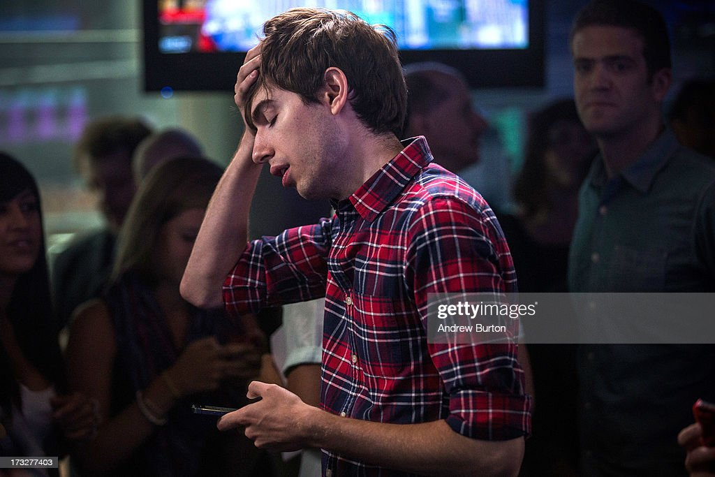 David Karp, founder of the micro-blogging site Tumblr, uses his phone before opening the NASCAQ Exchange on July 11, 2013 in New York City. Tumblr was bought by Yahoo! for $1 billion in May; Karp is estimated to be worth $200 million.