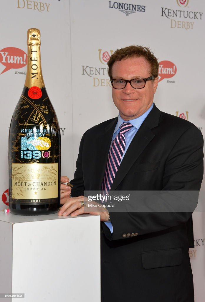 <a gi-track='captionPersonalityLinkClicked' href=/galleries/search?phrase=David+Keith&family=editorial&specificpeople=241261 ng-click='$event.stopPropagation()'>David Keith</a> signs the Moet & Chandon 6L for the Churchill Downs Foundation during the 139th Kentucky Derby at Churchill Downs on May 4, 2013 in Louisville, Kentucky.