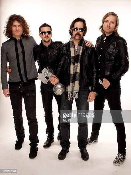 David Keuning Ronnie Vannucci Brandon Flowers and Mark Stoermer of The Killers winners of The Best Rock Award poses for a portrait in the backstage...